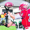 Beekmantown's Justin Stevens (right) makes a spectacular one-handed grab while being tailed by Franklin Academy's Jarret Lamica (82) during Saturday's NYSPHSAA Class B regional semifinal football game at AuSable Valley Central School. The Eagles defeated the Huskies, 51-14.<br><br>(P-R PHOTO/GABE DICKENS)