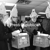 Getting in the spirit of Thanksgiving, the Tyler family - from left, Ava, Zoe, Karen and Jim - of Saranac Lake prepares boxes of free mealsto be delivered to Saranac Lake residents. About 100 dinners were prepared and served at the Senior Citizens Center in downtown Saranac Lake. This is the fourth year the Saranac Lake Women's Civic Chamber, St. Joseph's Recovery Center and the Senior Center have provided thefree community service.<br><br>(P-R PHOTO/JACK LADUKE)