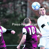 Chazy's Josh Barriere (right) heads the ball as two Harrisville opponents look on during Saturday's NYSPHSAA Class D regional final boys' soccer game at the Plattsburgh Athletic Complex. Chazy won 10-0.<br><br>(P-R PHOTO/GABE DICKENS)