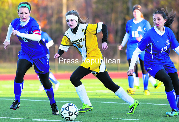 Seton Catholic's Maddison Murnane (from left) and Northern Adirondack's Rachael Venne race for a loose ball as Murnane's teammate, Reilly Boule, trails the play, during Wednesday's Section VII Class C girls' championship soccer game at the Plattsburgh Athletic Complex.<br><br>(P-R PHOTO/GABE DICKENS)