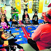"Plattsburgh Public Library Assistant Karen Ricketson reads ""Hoodwinked"" to costumed children on Tuesday in the Children's Room. The little ones were treated to spooky stories, witchy songs and other ghoulish stuff.<br><br>(STAFF PHOTO/ROB FOUNTAIN)"