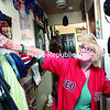 Plattsburgh resident Elizabeth Dapo, a die-hard Boston Red Sox fan, shows off some of her memorabilia collection, which includes her red David Ortiz jersey, several hats and dozens of pictures of the team, along with articles about the games and players that she clipped out of the newspaper and taped to the walls and refrigerator of her home.<br><br>(P-R PHOTO/GABE DICKENS)