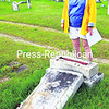 "Juanita Napper stands by a tombstone in Hillside Cemetery in Westport that was toppled by the elements. Among those interred in the old burial ground are local celebrity Joseph Call, known as the ""Lewis Giant,"" and American Revolutionary War veteran Ebenezer Durfie.<br><br>(P-R PHOTO/ALVIN REINER)"