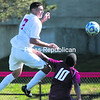 Plattsburgh's Ethan Votraw (left) heads the ball away from the Cardinals' net and past Potsdam's Eduardo Figueroa during Saturday's men's soccer SUNYAC opener at the Field House Athletic Complex. Plattsburgh won by a score of 4-0.<br><br>(P-R PHOTO/GABE DICKENS)