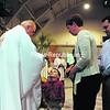 Three-year-old Anthony Best of Brasher Falls speaks with Archbishop Carlo Maria Viganò, apostolic nuncio to the United States, during communion service Sunday in Lake Placid.<br><br>(P-R PHOTO/JACK LADUKE)