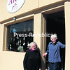 Artists and business partners Jeanne Danforth (left) and Jeanne Norris stand at the entrance to their new business, the Main Street Gallery, on the ground floor of the Richardson Building on East Main Street in Malone.<br><br>(Staff Photo/Denise A. Raymo)