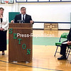 Seton Schools Education Council President Chris Hay speaks at a press conference Monday at Seton Catholic Central while Seton Director of Development Lynn Gilbert and Msgr. Dennis Duprey, pastor of St. Peter's Parish in Plattsburgh, look on. Seton's sixth-grade class will move from Seton Academy to Seton Catholic Central this fall due to increasing enrollment. <br><br>(ASHLEIGH LIVINGSTON/P-R PHOTO)