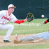 Cortland's Donny Castaldo (12) slides under the tag of Cardinals' shortstop Brian Latulipe (11) Sunday during a game at Chip Cummings Field in Plattsburgh.<br><br>(ROB FOUNTAIN/STAFF PHOTO)