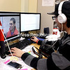 Photo Editor Alex Ayala watches a video interview for his athlete feature story.<br><br>(JESS HUBER/P-R PHOTO)
