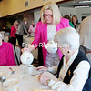 Lake Forest Senior Living activities director Shirley Sansone pours tea for residents Nan Mitchell (left) and Sylvia Brown during the Spring Tea and Fashion Show.<br><br>(ROB FOUNTAIN/STAFF PHOTO)