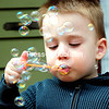 On a sunny afternoon, 4-year-old Cooper Stoyanoff blows with bubbles on the front steps of his Plattsburgh home. The forecast for the rest of the week calls for warmer temperatures and sunny skies, so look for more people to be outside soaking up the sun.<br><br>(ROB FOUNTAIN/STAFF PHOTO)