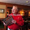 Ron Butler in the dining room at the Lake Placid Howard Johnson's restaurant, which he recently sold. The fried-fish dinner there used to serve upward of 700 people a night.<br><br>(JACK LaDUKE/P-R PHOTO)