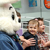 Ada Dubay is all smiles with the Easter Bunny while her brother, Cooper, is not as sure on Sunday during Bunny Cares at Champlain Centre mall in Plattsburgh. The event was planned for children with special needs and their families to have photos taken in a supportive environment. The event was scheduled in the quiet period before regular mall hours.<br><br>(ROB FOUNTAIN/STAFF PHOTO)