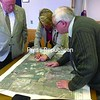 Plans to develop a joint solar-energy array at the former Village of Malone landfill were presented to Franklin County legislators recently. Here viewing a map of the proposed site are (from left): Bill Buchan, an environmental attorney working with the village; Village Trustee Andrea Dumas; and County Legislator Gordon Crossman (D-Malone).<br><br>(DENISE A. RAYMO/Staff Photo)