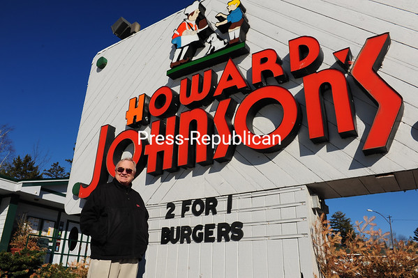 Ron Butler stands outside the Howard Johnson's sign in Lake Placid. He owned and operated the restaurant on Saranac Avenue from 1958 until its recent sale.<br><br>(JACK LaDUKE/P-R PHOTO)