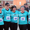 Members of Team Sole Mates (from left) Jill Polniak, Eustacia Sheppard, Lori Montpetit, Amy Lemke and Nicole Dailey, all from Ogdensburg, pose for a photo before the start of the half marathon.<br><br>(ROB FOUNTAIN/STAFF PHOTO)