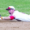 Plattsburgh State's Mike Vargues dives to knock down a sharply-hit ball during the second game of a doubleheader against Cortland at Chip Cummings Field in Plattsburgh Saturday afternoon.<br><br>(GABE DICKENS/P-R PHOTO)