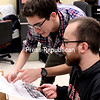 Staff Photographer Mike Dorsey (left) learns how to copy edit with help from Managing Editor Brian Molongoski.<br><br>(JESS HUBER/P-R PHOTO)
