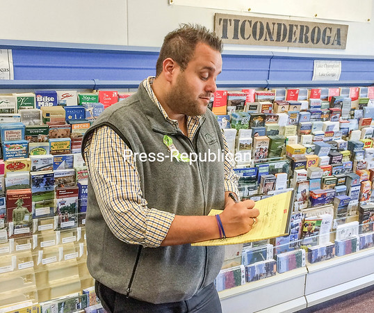 Ticonderoga Area Chamber of Commerce Executive Director Matthew Courtright looks over notes for a merger with the Crown Point Chamber. The Crown Point group will dissolve as a separate entity on May 1.<br><br>(LOHR MCKINSTRY/STAFF PHOTO)