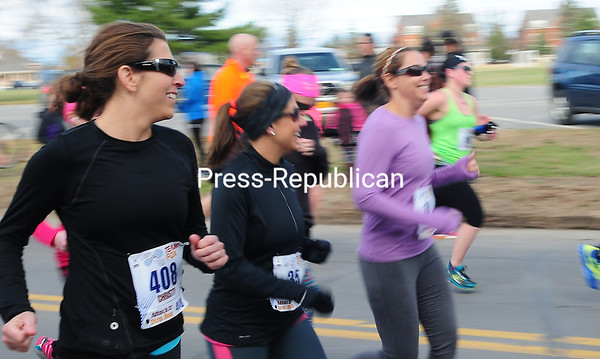 Christy Tupper (408) of Hermon, N.Y., is all smiles heading out at the start of the race.<br><br>(ROB FOUNTAIN/STAFF PHOTO)