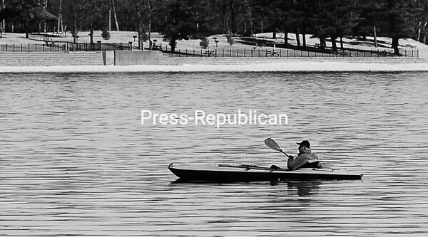 With calm waters, a lone kayaker paddles gently across the surface of Lake Champlain in Cumberland Bay near Wilcox Dock in Plattsburgh recently. <br><br>(ROB FOUNTAIN/STAFF PHOTO)
