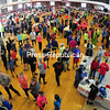 Runners, volunteers, family members and friends fill up the City Recreation Center just before the start of the Plattsburgh Half Marathon Sunday.<br><br>(ROB FOUNTAIN/STAFF PHOTO)