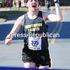 Michael Schram (375) of Tupper Lake, wins the Plattsburgh Half Marathon Sunday at the U.S. Oval. <br><br>(ROB FOUNTAIN/STAFF PHOTO)