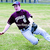 Northeastern Clinton's Cody Lacey makes a sliding stop on a sharply hit ball to right field during a Champlain Valley Athletic Conference baseball game against Beekmantown at Lefty Wilson Field Friday. Beekmantown won 12-8.<br><br>(GABE DICKENS/P-R PHOTO)