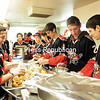 The Beekmantown High School hockey team helps out in the Trinity Soup Kitchen Wednesday at the Trinity Episcopal Church in Plattsburgh. (ROB FOUNTAIN/STAFF PHOTO)