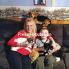 Becky Priest and her son Isaiah pose with cats (from left) Cry Baby, Mooch, Batty and Stitch and family dog Tiny in their Mooers Forks home Wednesday. Becky and other family members help Isaiah collect cans and bottles to help take care of the cats they take in. (CARA CHAPMAN/STAFF PHOTO)