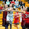 AuSable Valley's Vanessa Garrow (5) drives to the basket through Saranac's Christina Bedard (54) and Skye O'Connell (34) during CVAC girls' basketball action Wednesday in Clintonville. (ROB FOUNTAIN/STAFF PHOTO)
