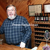 Richard Lamoy, owner of Hid-In-Pines Vineyard in Morrisonville, shows their new wine-tasting room, which he'll be working on throughout the winter and spring. He is enthusiastic about seeing his products used in local restaurants.<br><br>(GABE DICKENS/P-R PHOTO)