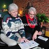 Barbara Davidson (left) and Margi Carter, co-chairs of the Keeseville Business Association, look over a business brochure on Tuesday in Keeseville. The next meeting of the new group - which wants to grow with additional members - is at 4:30 p.m. Tuesday, March 10, at the North Country Club.<br><br>(ROB FOUNTAIN/STAFF PHOTO)