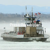 With temperatures below zero and a brisk wind, a Lake Champlain Transportation Co. ferry pushes through icy waters heading for Grand Isle, Vt., Tuesday from Cumberland Head. The ferry at that location runs 24 hours a day year-round, weather permitting. Forecasts call for temperatures to slowly rise into the mid-20s through the weekend with partly sunny skies.<br><br>(ROB FOUNTAIN/STAFF PHOTO)