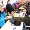 Laurie Williams (left) checks in with Clinton County Health Department dispenser Karen Plotas-McGrath on Thursday during a drill at the Crete Memorial Civic Center in Plattsburgh. Pretending the North Country was dealing with a biological attack, health workers practiced handing out antibiotics quickly to hundreds of people. Their goal was to treat 440 people in two hours.<br><br>(ROB FOUNTAIN/STAFF PHOTO)