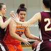 Clinton's Sharon Yarbough (22) tries to drive through Jefferson's Alyssa Crosby (24) and Kathleen Coloney (23) Sunday during women's basketball action in Plattsburgh.<br><br>(ROB FOUNTAIN/STAFF PHOTO)