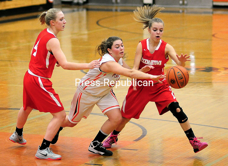 Plattsburgh's High's Kelsey Senecal (23) tries to slip through Beekmantown's Kenna Guynup (4) and Alyssa Waters (2) during a Northern Basketball League contest Monday. <br><br>(ROB FOUNTAIN/STAFF PHOTO)