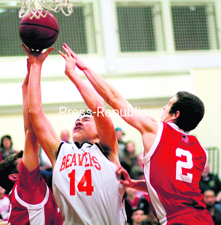 Keene's Wayne Shih goes up with shot after an offensive rebound as Schroon Lake's Alex Shaughnessy and Tanner Stone defend during Friday's boys' Northern Basketball League contest at Keene. Game results from this game were not received in time for press.<br><br>(ALVIN REINER/P-R PHOTO)