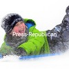 """With snow flying all around him, Noah Hastings comes to a stop at the bottom of the hill Saturday at North Country Community College's soccer field in Saranac Lake. Hastings was sliding with aunt, Heather Fehlner, who lives in Texas. """"I come sliding almost everyday,"""" said Hastings, """"I Love it.""""<br><br>(ROB FOUNTAIN/STAFF PHOTO)"""