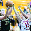 Northern Adirondack's Paige Chilton (left) and Taylor Durnin go up for a rebound against AuSable Valley's Kourtney Keenan during Thursday's Northern Basketball League match-up at AuSable Valley Central School.<br><br>(GABE DICKENS/P-R PHOTO)