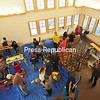 Saranac Lake High School Ski Team members are seen from the second floor of the new Dewey Mountain Lodge, waxing their skies in preparation for an upcoming competition. The new facility at Dewey Mountain Recreation Center in Harrietstown will be formally opened Saturday, Jan. 10. Funds raised locally paid for the project; one 5-year-old girl donated $1.70, while another anonymous donor gave $10,000. The Town of Harrietstown will maintain the lodge.<br><br>(JACK LADUKE/P-R PHOTO)