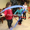 """Mali Giddings (left) and Calla Allen perform a ribbon dance for peace Monday during the """"How You Can Change Your World"""" event in observance of Martin Luther King Jr. Day at the Imaginarium Children's Museum in Plattsburgh. Music and a variety of activities allowed children to celebrate their diverse community.<br><br>(ROB FOUNTAIN/STAFF PHOTO)"""