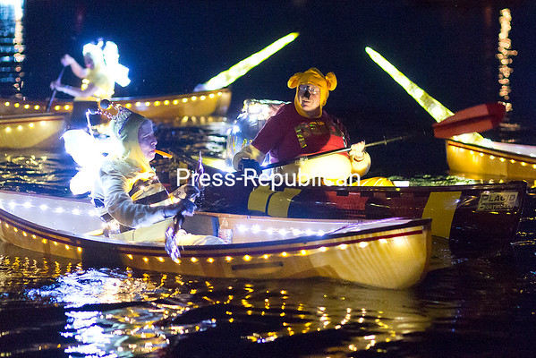 "Winnie the Pooh and the Queen Bees take part in the nith-annnual Mayor's Cup Regatta and Festival Boat Parade of Lights Thursday evening on Lake Champlain near Dock Street Landing in Plattsburgh. The Mayor's Cup continues through Sunday, July 12. For more information, visit  <a href=""http://www.mayorscup.com"">http://www.mayorscup.com</a>. (Gabe Dickens/P-R Photo)"