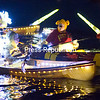 """Winnie the Pooh and the Queen Bees take part in the nith-annnual Mayor's Cup Regatta and Festival Boat Parade of Lights Thursday evening on Lake Champlain near Dock Street Landing in Plattsburgh. The Mayor's Cup continues through Sunday, July 12. For more information, visit  <a href=""""http://www.mayorscup.com"""">http://www.mayorscup.com</a>. (Gabe Dickens/P-R Photo)"""