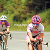 Two cyclists ride a section of the Ironman Lake Placid bike course on Route 86 in Wilmington Friday. Today's triathlon will include a 112-mile bike ride. (Courtney Lewis/Staff Photo)