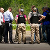 State Police search teams get a briefing as they break for water after a door-to-door search Friday in Skerry, looking for escapees Richard Matt and David Sweat. Matt was later shot and killed by a U.S. Customs and Border Protection tactical team. (CHRIS LENNEY/P-R PHOTO)