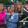 "North Country residents gather at the State Police Troop B barracks in Malone to listen to Gov. Andrew Cuomo and law enforcement officials Friday. They cheered and applauded when New York State Police Superintendent Joseph D'Amico, noting 2,400-plus leads had come in to help with the investigation, thanked the public for their ""patience and support and looking out for our officers."" (CHRIS LENNEY/P-R PHOTO)"