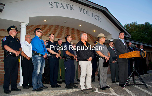 At a news conference Friday in Malone, Gov. Andrew Cuomo describes the incidents that led to the shooting of escaped Clinton Correctional inmate Richard Matt. At his right is New York State Police Superintendent Joseph D'Amico, who pledge nonstop effort to track down David Sweat. Also represented are: the State Department of Corrections and Community Supervision, State Department of Environmental Conservation, the FBI, U.S. Marshals, U.S. Customs and Border Patrol, Vermont State Police, Clinton and Franklin county DA's offices and sheriff's departments, Plattsburgh City Police, Malone Village Police and St. Regis Mohawk Tribal Police.  (CHRIS LENNEY/P-R PHOTO)