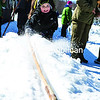 "Cub Scout Pack 63 member Ethan Madill of Westport competes in a Native American game of snow snake, in which a player throws a ""snake,"" usually fashioned from wood with a weighted tip, along a raised trough of snow, with the goal of gaining as much distance as possible. The activity was part of the Adirondack District Cub Klondike, held recently at the Cadyville Recreation Park. Other activities included cross-country skiing, snowshoeing, ice skating and sled races.<br><br>(GABE DICKENS/P-R PHOTO)"