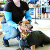 Tails of the Adirondacks employee Jessie Senecal spends some time with her dog, Samson, a Labrador-Rhodesian ridgeback mix, at the Plattsburgh pet-supply shop. Senecal and her family recently bought Samson a sweater because of the abnormally cold temperatures this winter.<br><br>(GABE DICKENS/P-R PHOTO)